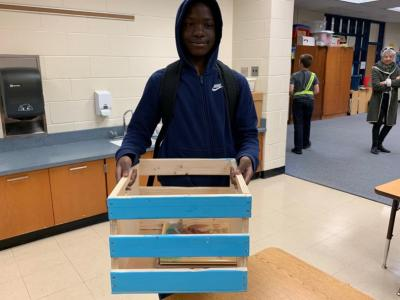 Student with crate