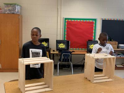 Photo of boys with crates